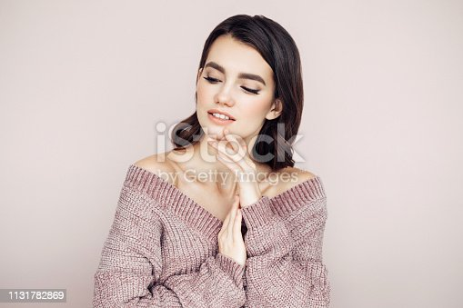 928358464istockphoto Beautiful woman with curly hair 1131782869