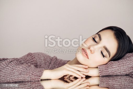 928358464istockphoto Beautiful woman with curly hair 1131783192
