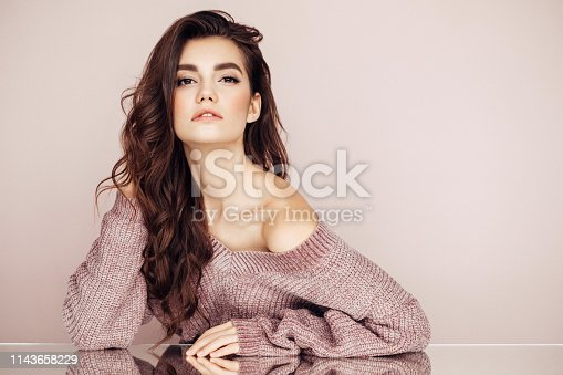 928358464istockphoto Beautiful woman with curly hair 1143658229