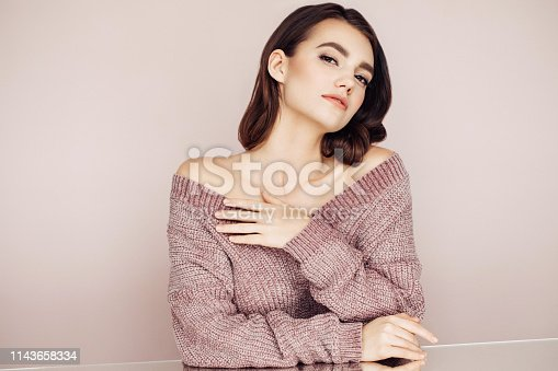 928358464istockphoto Beautiful woman with curly hair 1143658334