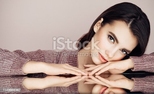 928358464istockphoto Beautiful woman with curly hair 1143658362