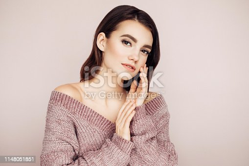 928358464istockphoto Beautiful woman with curly hair 1148051851