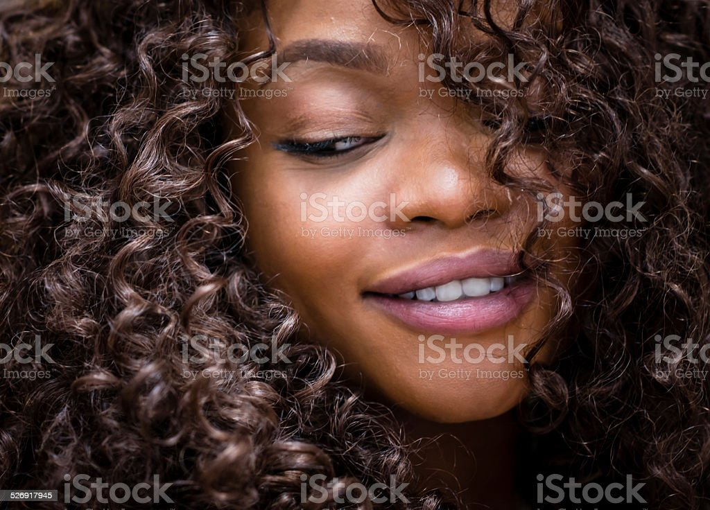 Beautiful woman with curly hair stock photo