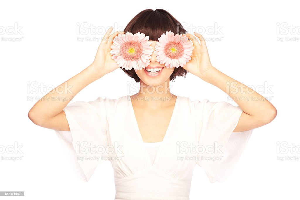 Beautiful woman with daisies in front of her eyes royalty-free stock photo