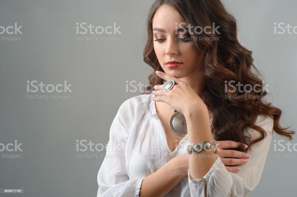 beautiful woman with evening make-up jewelry and beauty fashion photo stock photo