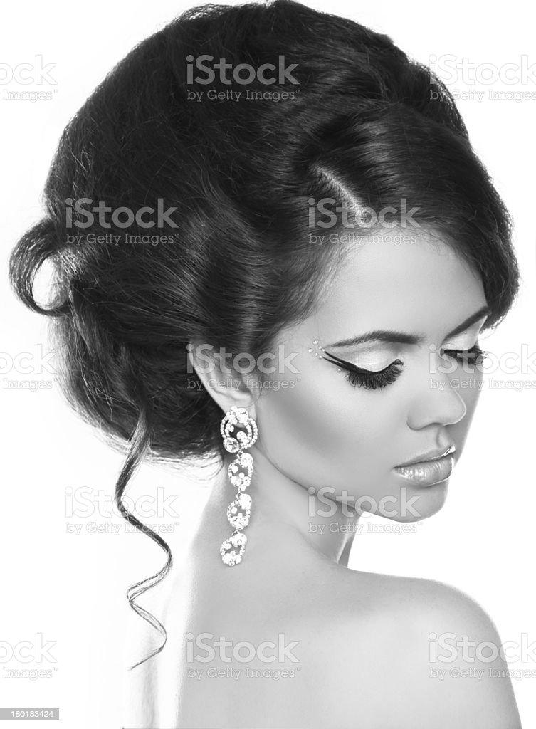 Beautiful woman with fashion hair and evening make-up. Jewelry royalty-free stock photo