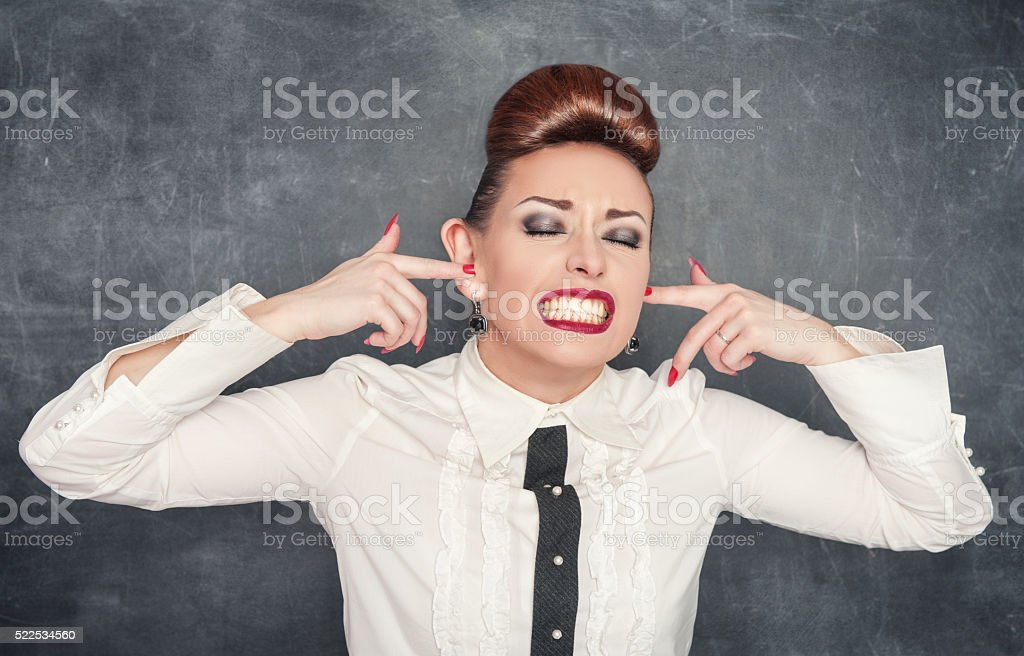 Beautiful woman with fingers in her big ears stock photo
