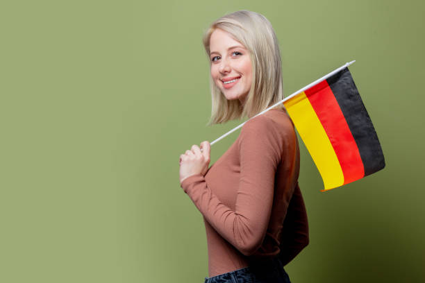 Beautiful woman with flag of Germany stock photo