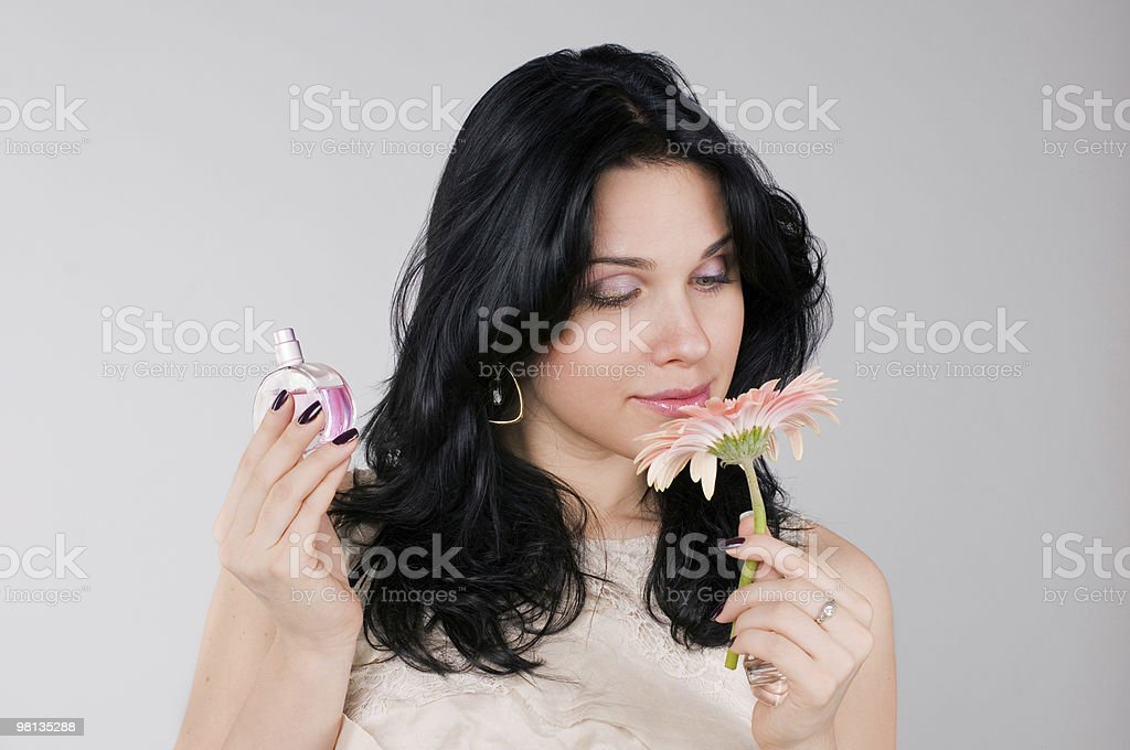 Beautiful woman with flower and  perfume. royalty-free stock photo