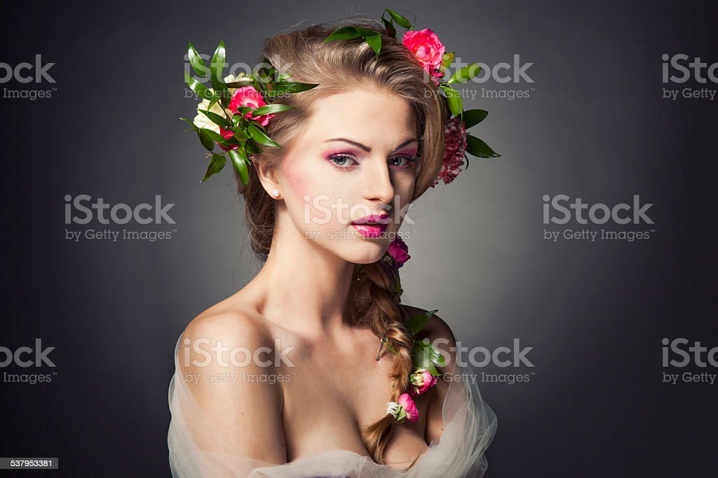 Beautiful woman with flowers in hair stock photo