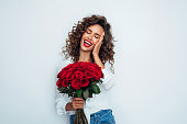 istock Beautiful woman with flowers 1296741495