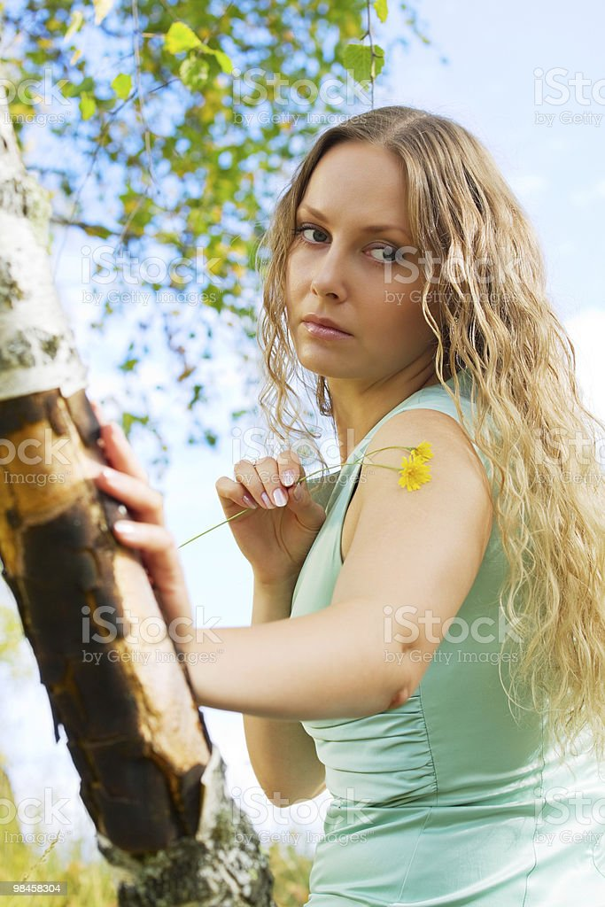 Beautiful woman with flowers royalty-free stock photo
