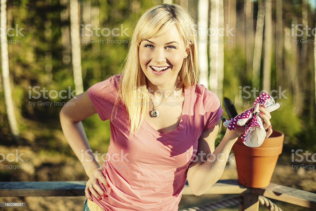 Beautiful woman with gardening gloves stock photo