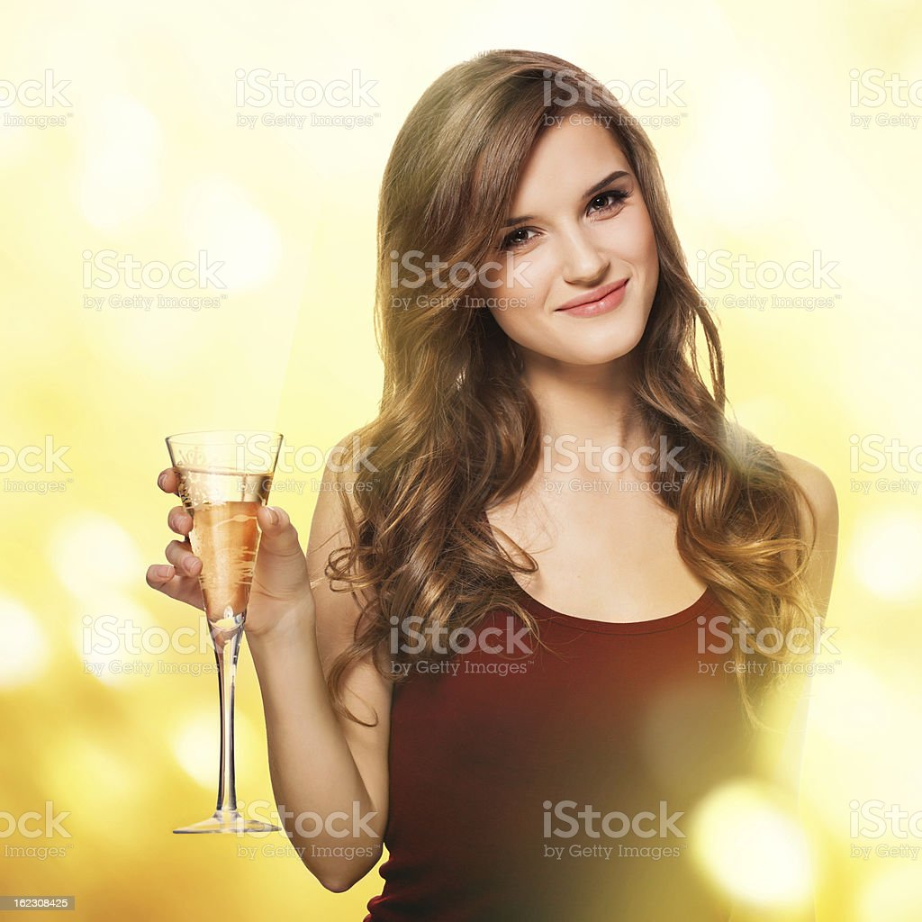Beautiful woman with glass of champagne stock photo
