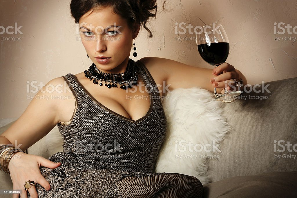 Beautiful woman with glass red wine royalty-free stock photo