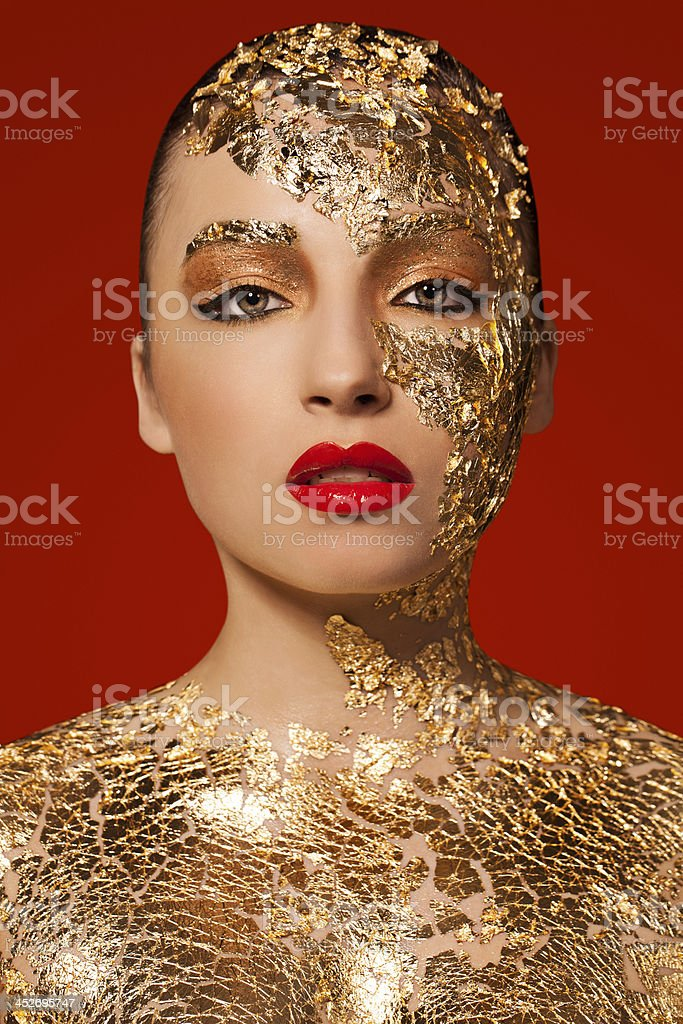 Beautiful Woman with Gold Leaf Beauty Portrait royalty-free stock photo