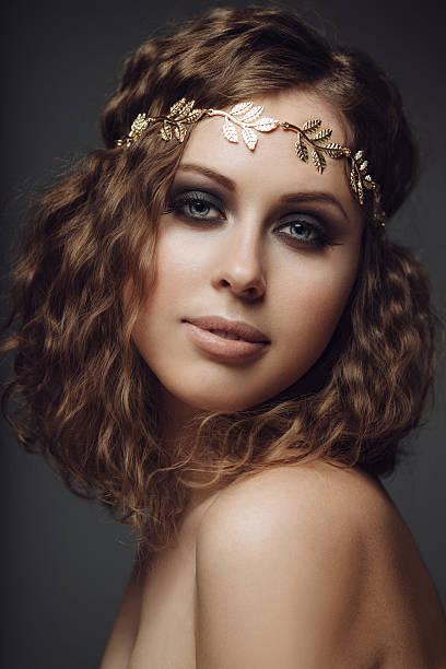 Beautiful woman with golden headband stock photo
