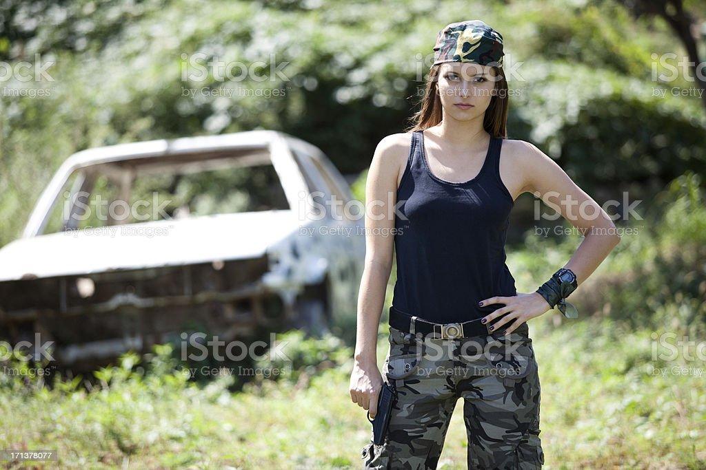 beautiful woman with gun royalty-free stock photo