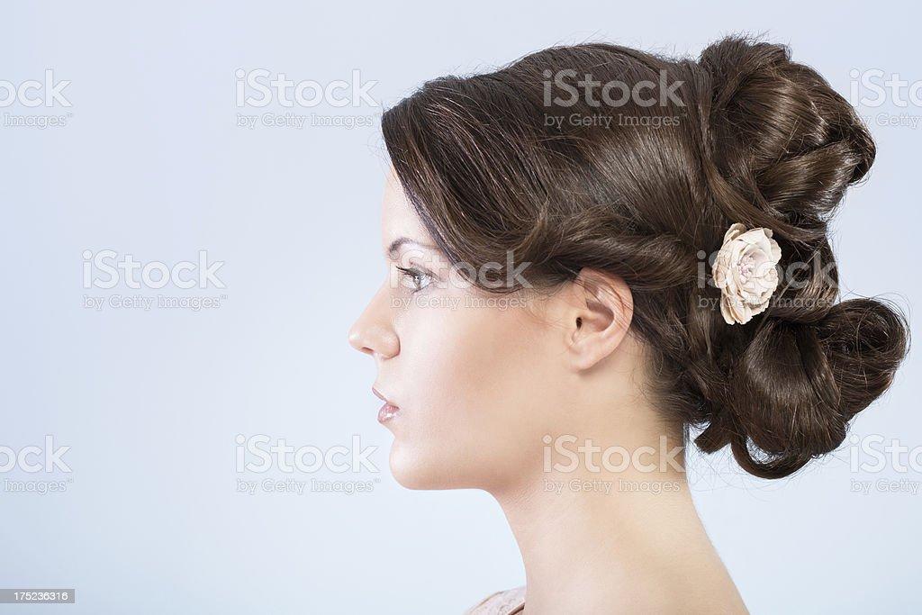 Beautiful woman with hair bun royalty-free stock photo