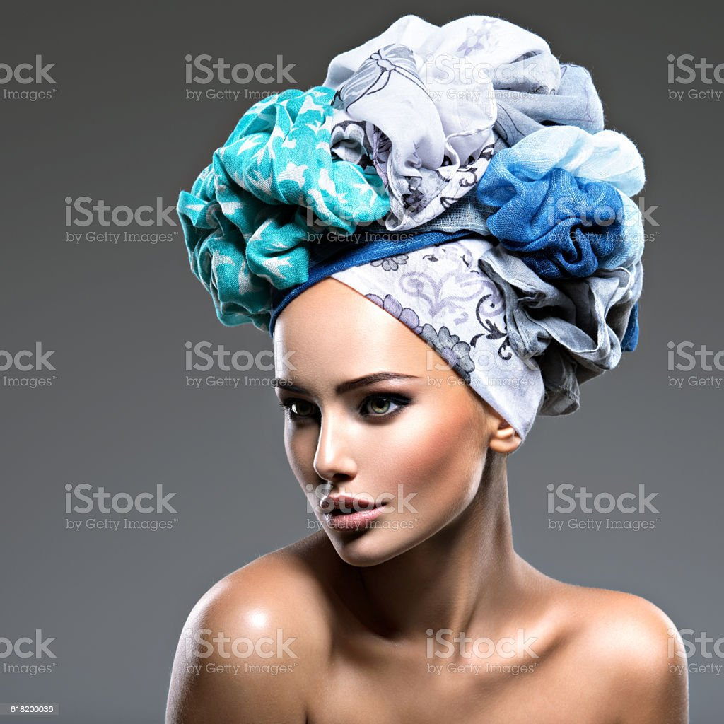 Beautiful woman with hairs wrapped in turban. stock photo