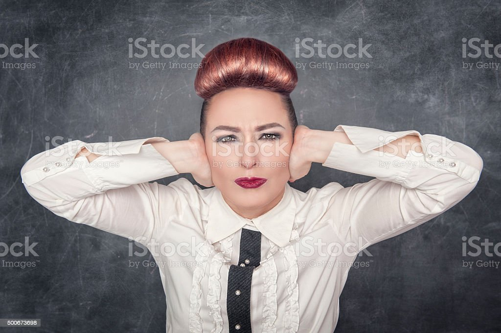 Beautiful woman with hands on her ears stock photo