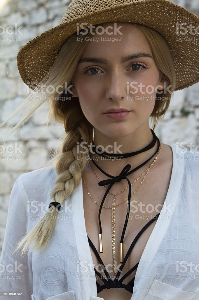 Beautiful woman with hat and pigtail stock photo