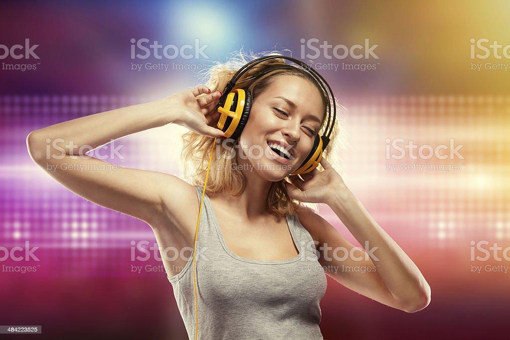 Beautiful woman with headphones listening music stock photo