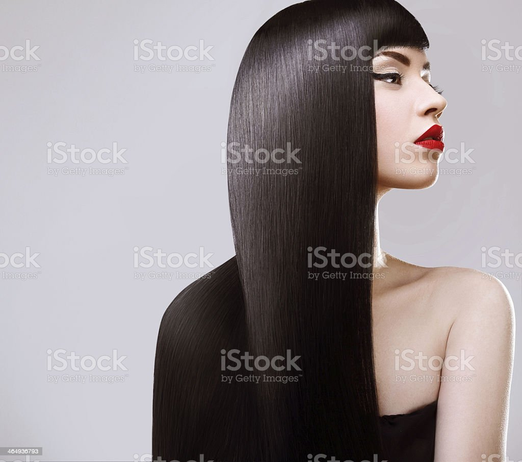 Beautiful Woman with Healthy Long Hair. Red Lips stock photo