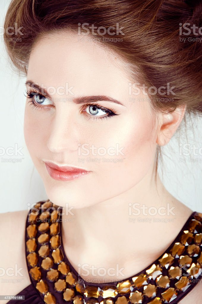 Beautiful woman with healthy pale skin and gray eyes smiling stock photo