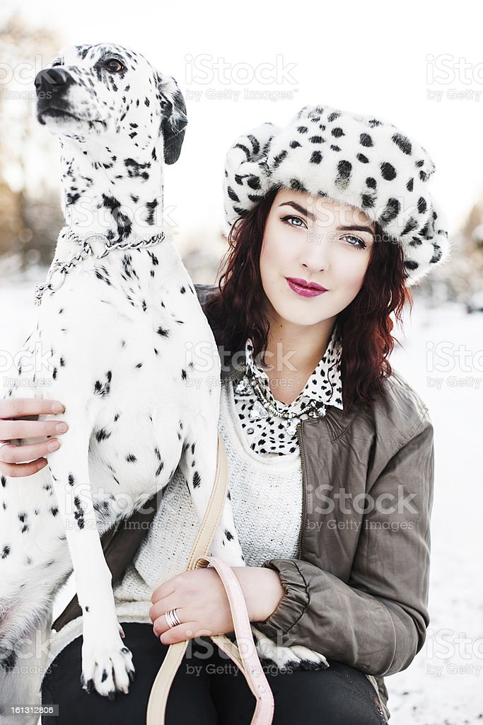 Beautiful woman with her dog stock photo
