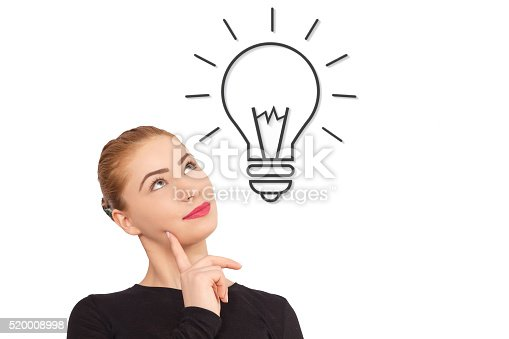 istock Beautiful woman with idea light bulb above 520008998