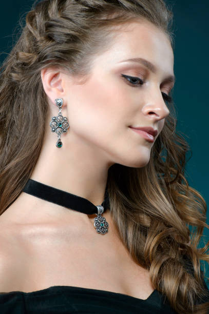 Beautiful woman with jewelry set. girl with fashionable jewelry necklace and earrings stock photo