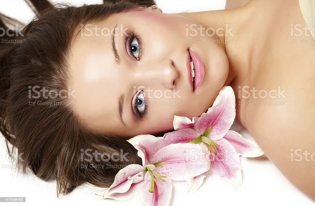 Beautiful woman with lily flower royalty-free stock photo