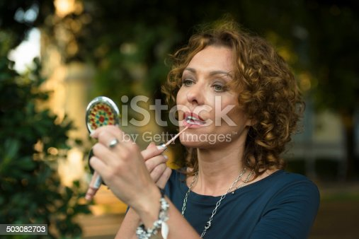 istock Beautiful Woman with Lipstick , Make up in City Park, Italy 503082703