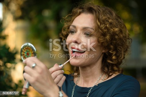 istock Beautiful Woman with Lipstick , Make up in City Park, Italy 503082707