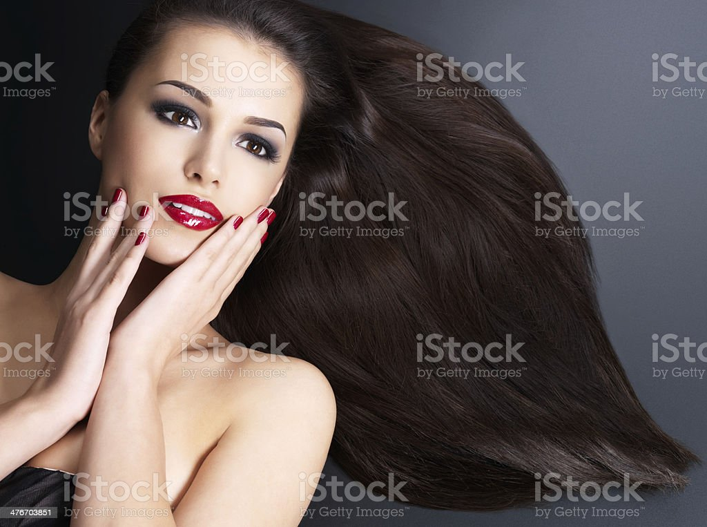 Beautiful woman with long brown straight hairs royalty-free stock photo