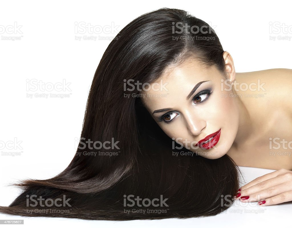 Beautiful woman with long brown straight hairs stock photo