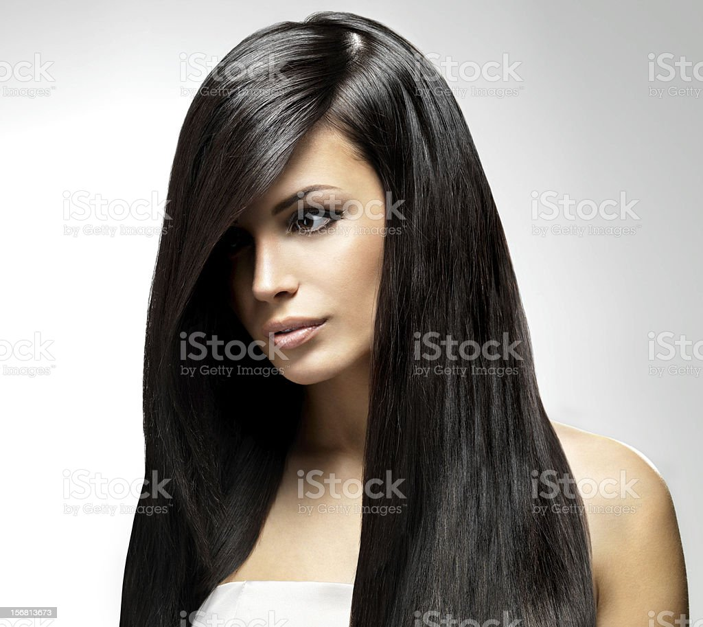 A beautiful woman with long, dark, and straight hair stock photo