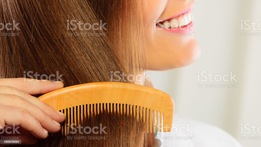 beautiful woman with long hair and comb stock photo