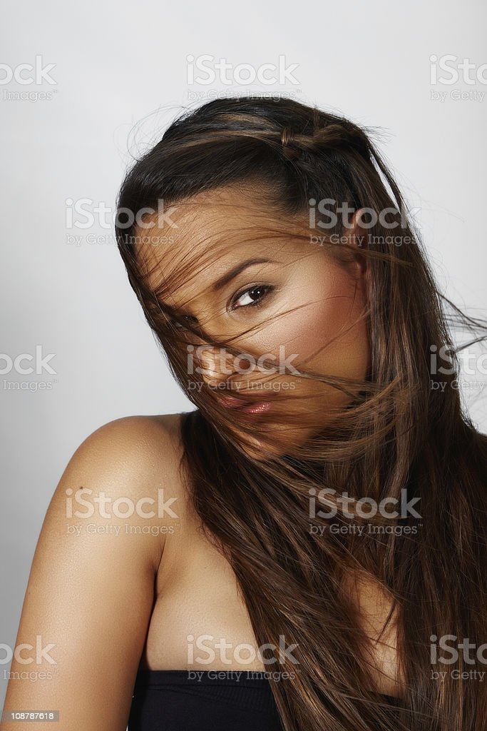 beautiful woman with long hair in wind royalty-free stock photo