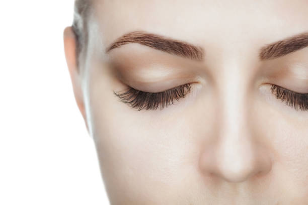 beautiful woman with long lashes in a beauty salon. - eyelid stock pictures, royalty-free photos & images