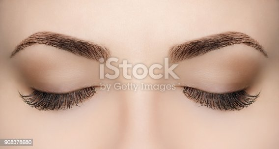 istock Beautiful Woman with long lashes in a beauty salon. 908378680