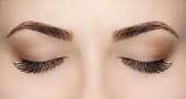 Beautiful Woman with long lashes in a beauty salon.