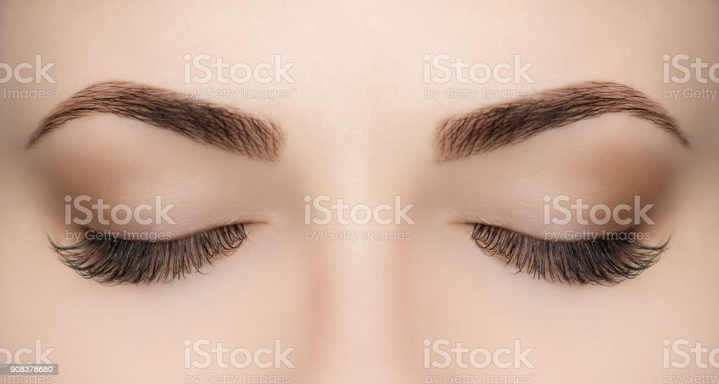 Beautiful Woman with long lashes in a beauty salon. stock photo