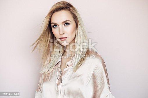 istock Beautiful woman with long straight hair 892366140