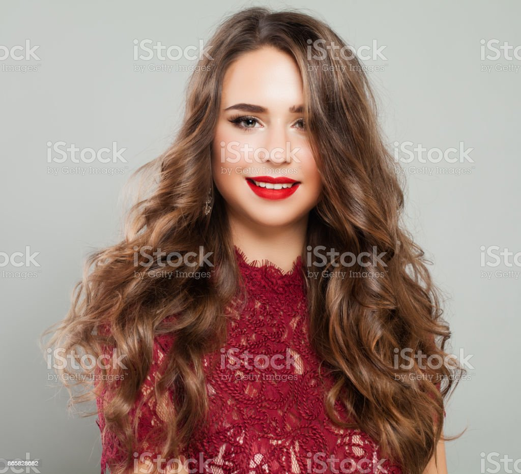 Beautiful Woman With Long Wavy Brown Hair Event Makeup And Red