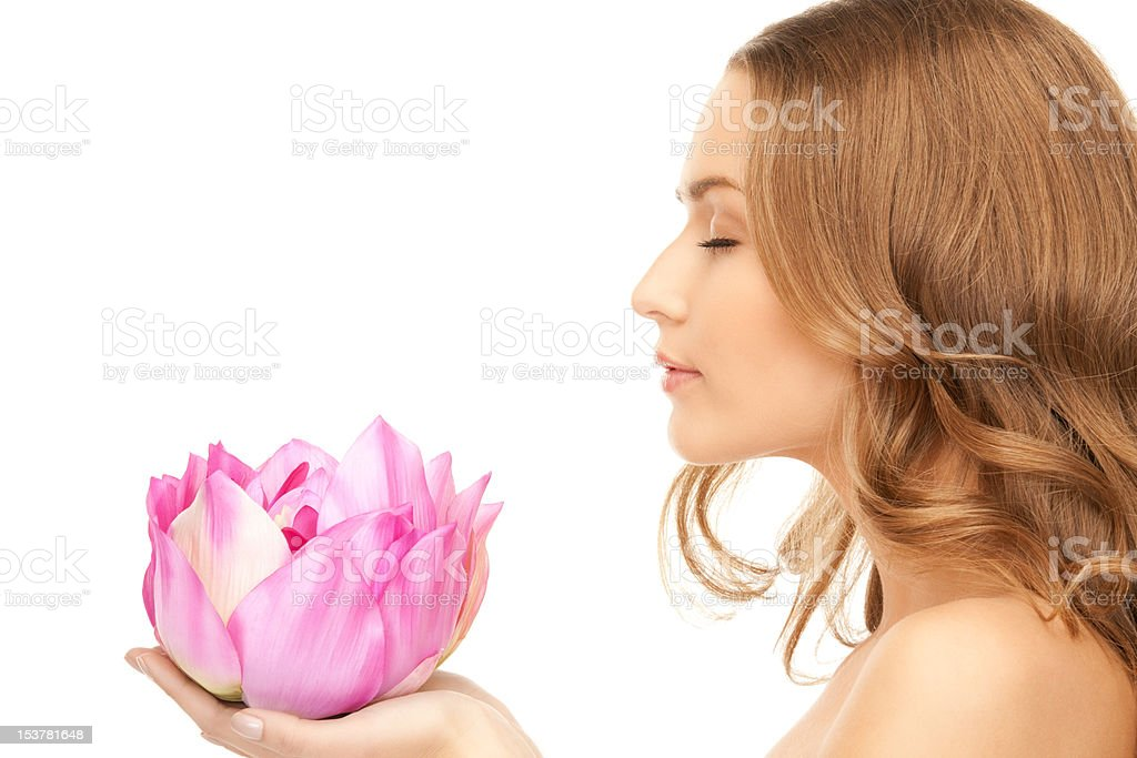 beautiful woman with lotus flower royalty-free stock photo