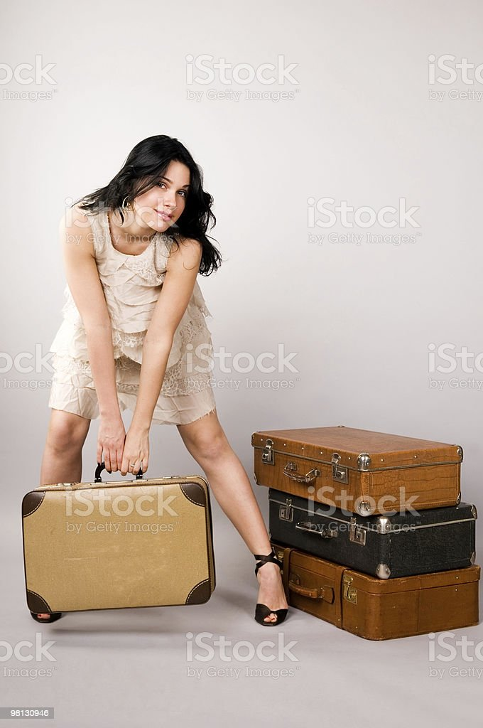 Beautiful woman with   luggage royalty-free stock photo