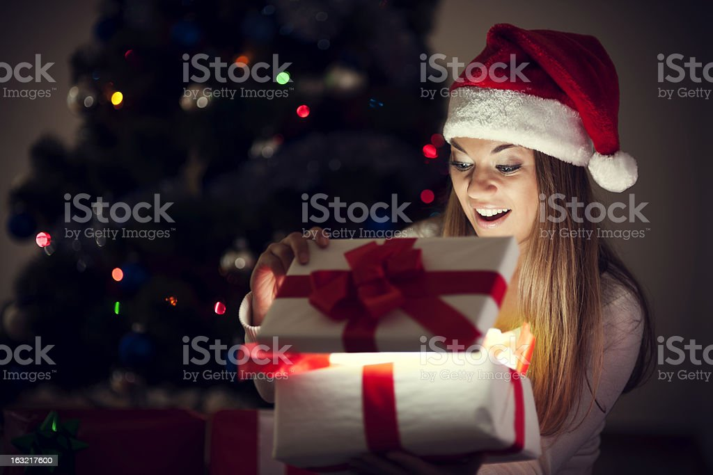 Beautiful woman with magic gift stock photo