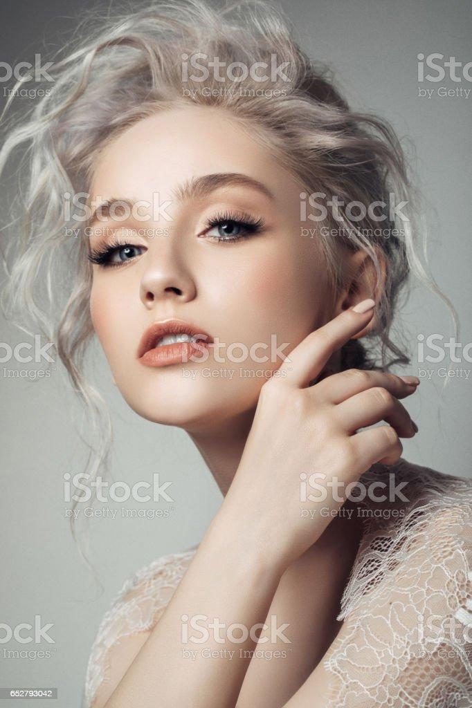Beautiful woman with make-up and stylish hairstyle stock photo